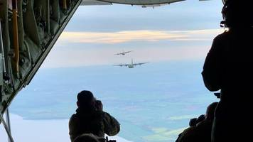 raf brize norton hercules captured in mid-air photoshoot