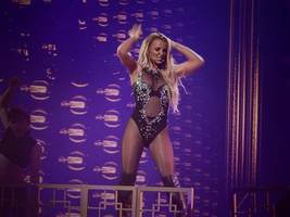 britney spears assures fans she'll be back on stage