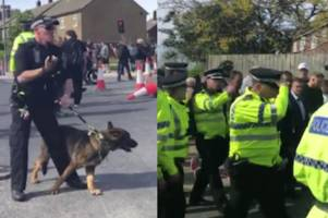 Tommy Robinson escorted from rally chaos as police with dogs clash with protesters