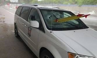 van passenger impaled by tripod thrown from overpass, survives