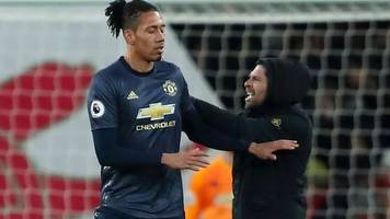 chris smalling assault: man admits charge during arsenal match