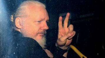 swedish prosecutors request detention order for julian assange