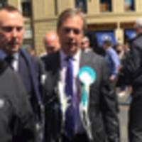 shaken and stirred: brexiteer farage splattered in uk milkshake attack