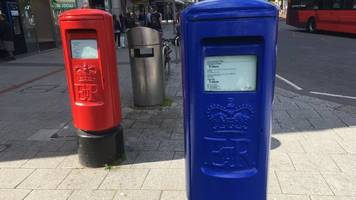 why are post boxes being painted blue?