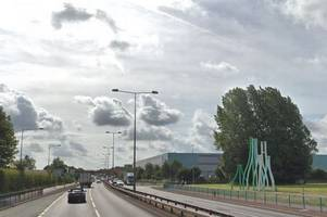 Police closed A50 after man 'threatened to jump' off bridge