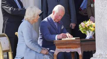 sun shines on charles and camilla for fermanagh garden party