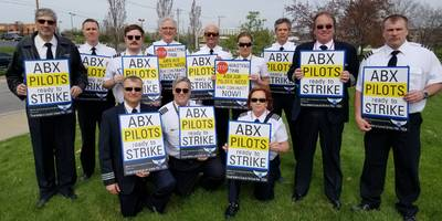 amazon air pilots are picketing the company's annual shareholder meeting as they fight for better pay (amzn, atsg)