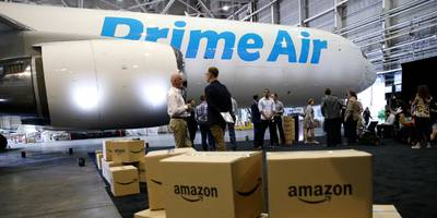 amazon threatens to cut its business with a cargo airline that delivers its packages if it can't reach a deal with frustrated pilots (amzn, aaww, atsg)