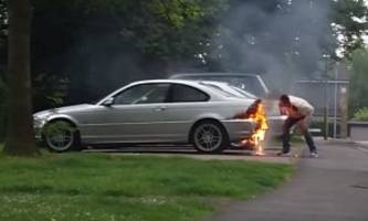 dude tries to put out fire on bmw by kicking, blowing on the flames