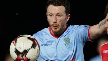 willie faulkner: midfielder joins carrick rangers after being released by ballymena