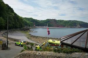 emergency services called after 'woman falls off cliff' - updates
