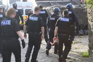 three held after police incident - live updates