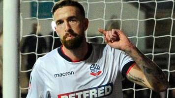 mark beevers: peterborough united sign centre-back after release by bolton