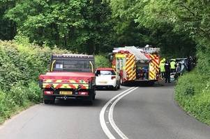 car ends up on side after south devon crash - live updates