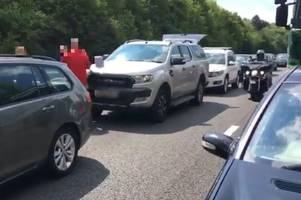 m11 traffic: motorists 'playing football and singing' after serious crash shut road