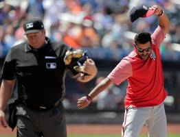 nats manager dave martinez kicks dirt on home plate, spikes cap after getting ejected