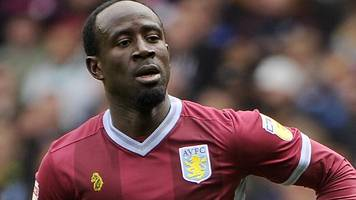 aston villa: albert adomah and glenn whelan among eight players released