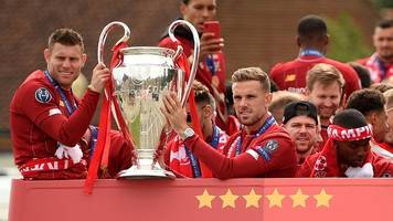 champions league: crowds gather for liverpool victory parade