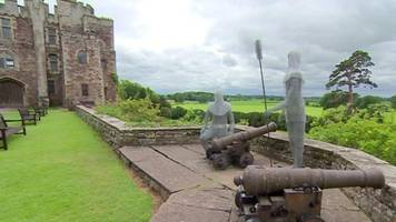 ghost-like sculptures adorn berkeley castle