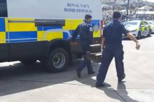 bomb squad called to harbour after 'missiles' find - live updates