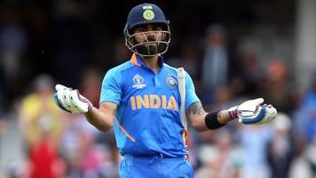 india's cricket captain defends rival from boos