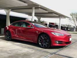 one of tesla's largest us supercharger stations has a plush, private customer lounge in the middle of a folksy california town — take a look inside (tsla)