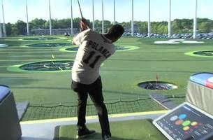 digital extra: twins take up golf at 'swing for the kids' event
