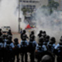 Hong Kong police use tear gas against protesters opposing extradition bill outside Government building