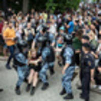 Police detain scores of Moscow protesters as anger simmers over journalist's arrest