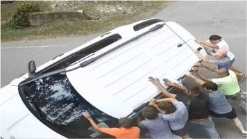 flipped car turned over by good samaritans