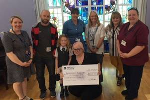 family present cheque to help wishaw hospital's bereavement suite