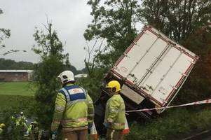 m6 crash lorry driver rushed to hospital with 'serious injuries' after plunge into embankment