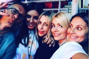 Holly Willoughby dances at Spice Girls gig while looking stunning in leather mini
