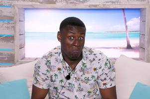 love island's sherif lanre booted off show for accidentally 'hurting female co-star in sensitive area'