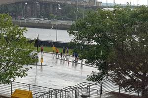 washout weather for glasgow men's 10k on father's day as runners power through rain