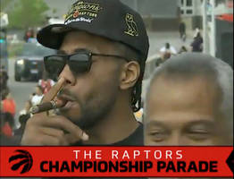 kawhi leonard rocks 'board man gets paid' t-shirt at raptors parade