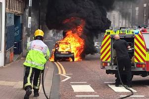 pictured: dramatic moment car explodes into flames on dudley high street