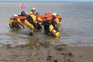 dramatic rescue of pair stuck in mud on cleethorpes beach caught on video