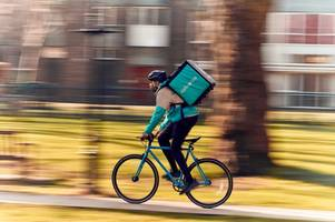 deliveroo distributes free face protection masks to cyclists to mark clean air day campaign