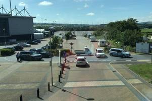 range rovers are used to block more travellers arriving at exeter chiefs car park