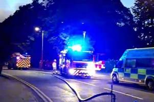 police and fire crews rush to large fire in building