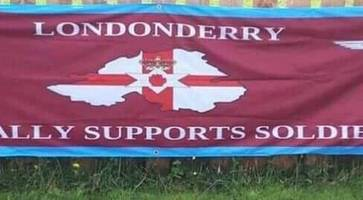calls for removal of controversial soldier f banner outside derry housing estate