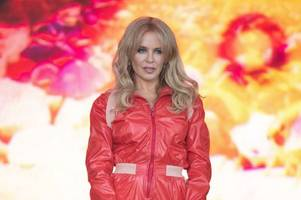 kylie minogue and the cure's robert smith donate clothing from glastonbury festival in  'stand against throwaway fashion'