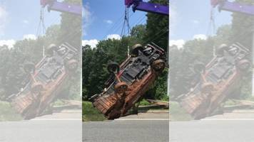 watch: enormous sinkhole swallows parked car in virginia