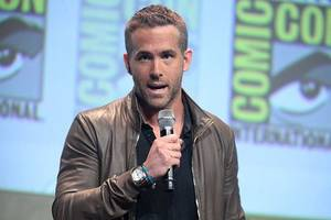 ryan reynolds joins gal gadot and dwayne johnson in red notice