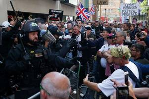 Tommy Robinson jailed for nine months as supporters clash with police outside court