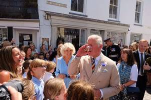 prince charles enjoys cheeky glass of captain morgan rum in mevagissey