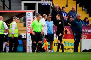 man named and charged after fan confronts steve bruce at lincoln city match