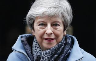 theresa may refuses to criticise police for warning journalists not to publish kim darroch leaks