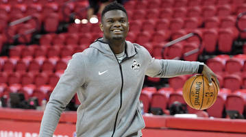 watch: zion williamson drains three-pointer while sitting on pelicans' bench